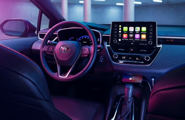 Interior front cabin of a 2020 Toyota Corolla, with Apple CarPlay on the infotainment screen.