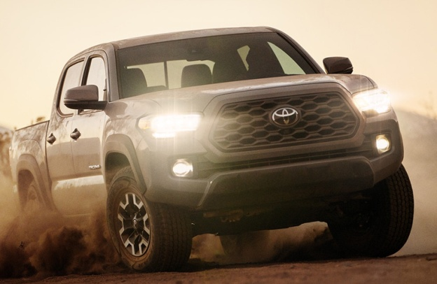 Quicksand-colored 2020 Toyota Tacoma drives through what may be literal quicksand.