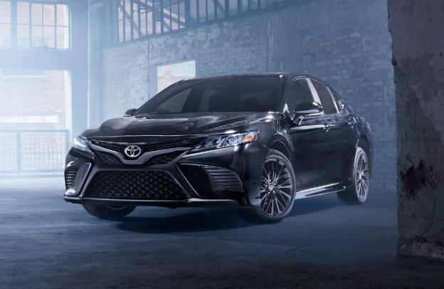 Black 2020 Toyota Camry in a mysterious concrete building.