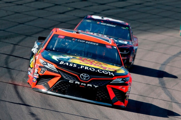 Toyota Camry TRD racing vehicle zips around a NASCAR track