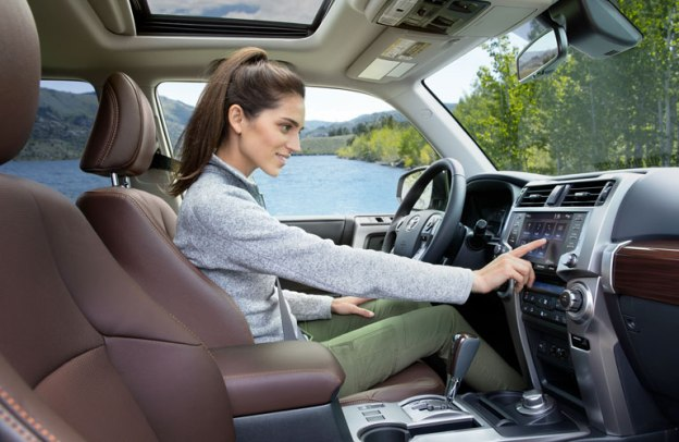 Woman interacts with infotainment screen inside a 2020 Toyota 4Runner