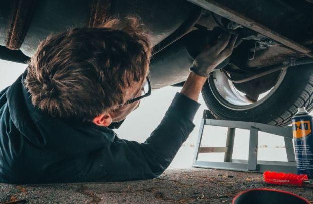 Man works on a car underneath