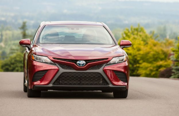 Head-on view of a red 2020 Toyota Camry Hybrid