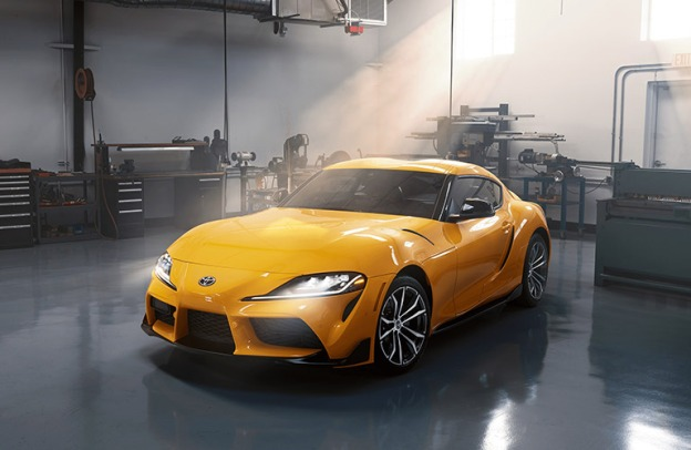 Yellow 2021 Toyota GR Supra in a garage