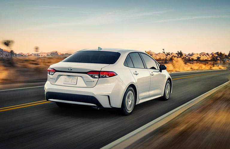 2021 Toyota Corolla Hybrid zips down a highway