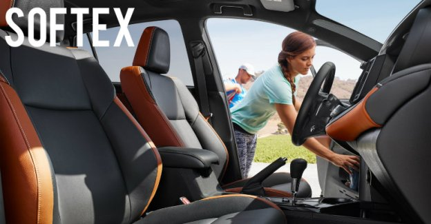 Woman reaches into car with Softex seats