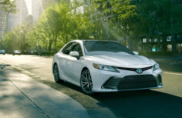 Front/side angled shot of white 2021 Toyota Camry