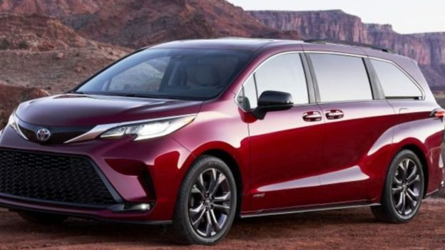 Close up image of 2021 Toyota Sienna in red before a mountain backdrop